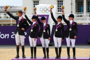 LONDON, ENGLAND - JULY 31:  The Great Britain team celebrate on the podium after winning the Silver medal in the Eventing Team Jumping Final Equestrian event on Day 4 of the London 2012 Olympic Games at Greenwich Park on July 31, 2012 in London, England.  (Photo by Alex Livesey/Getty Images)